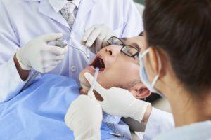 asian-man-having-dental-surgery-B578XAC